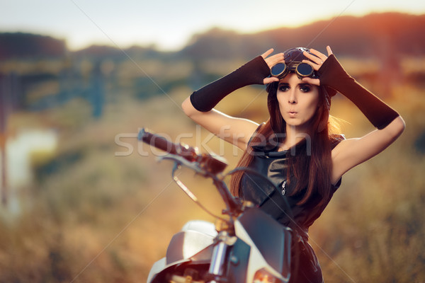 Surprised Steampunk Woman Next to Her Motorcycle Stock photo © NicoletaIonescu