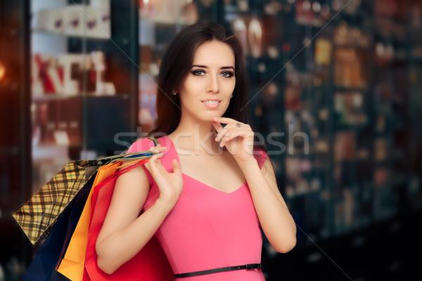 Feliz mujer compras tienda sonriendo nina Foto stock © NicoletaIonescu