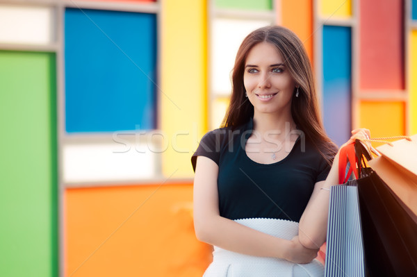 Happy Woman Shopping on Big Summer Sale Stock photo © NicoletaIonescu