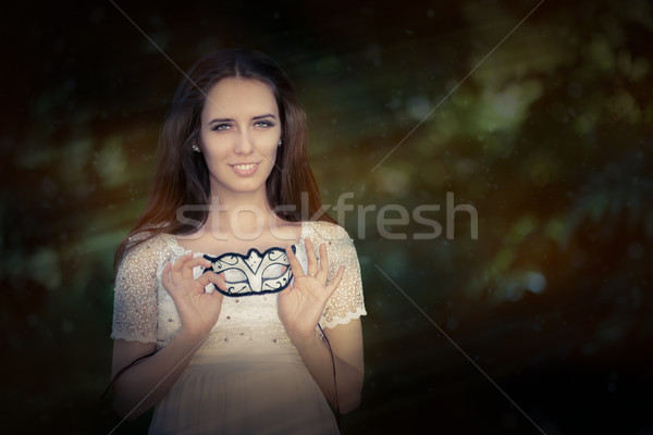 Young Woman in White Dress Holding Mask  Stock photo © NicoletaIonescu
