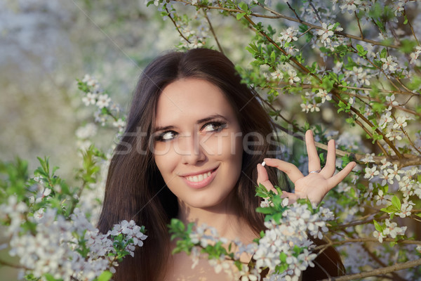 Woman with Allergy Holding Anti Allergic Pills in Spring Blooming Decor Stock photo © NicoletaIonescu