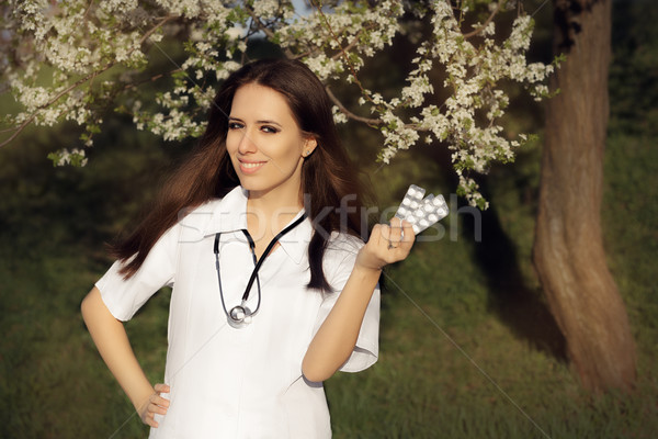 Spring Woman Doctor Smiling and Holding Pills Stock photo © NicoletaIonescu