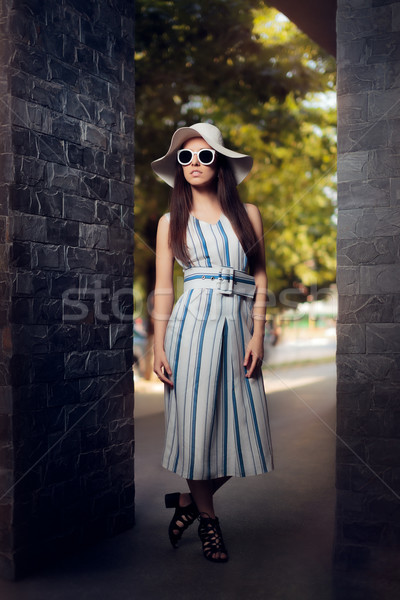 Woman in Summer Dress with Stripes Wearing Sunglasses and Hat Stock photo © NicoletaIonescu