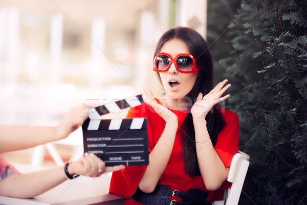 Surprised Actress with Oversized Sunglasses Shooting Movie Scene Stock photo © NicoletaIonescu