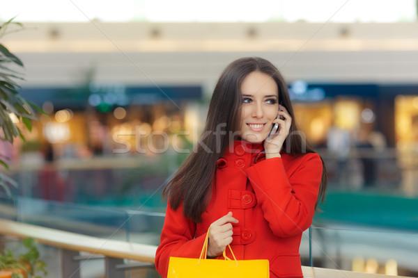 девушки красный пальто говорить смартфон Сток-фото © NicoletaIonescu