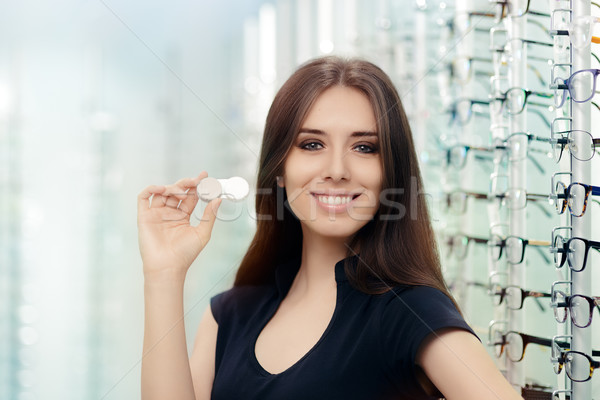 Woman with Contact Lenses Case in Optical Store Stock photo © NicoletaIonescu