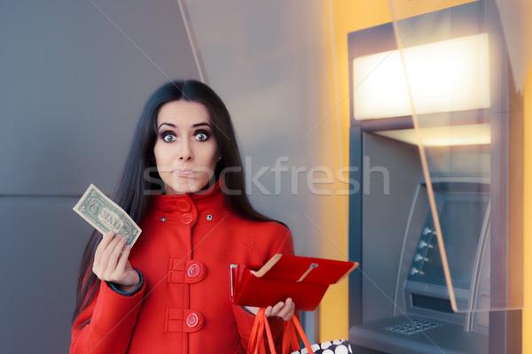 Nő tart egy dollár bankautomata vicces Stock fotó © NicoletaIonescu