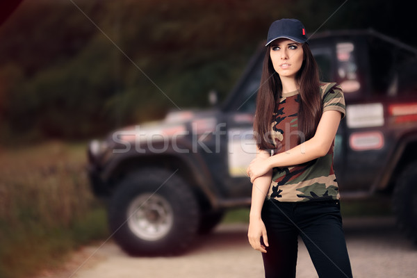 Female Driver in Army Outfit Next to an Off Road Car Stock photo © NicoletaIonescu