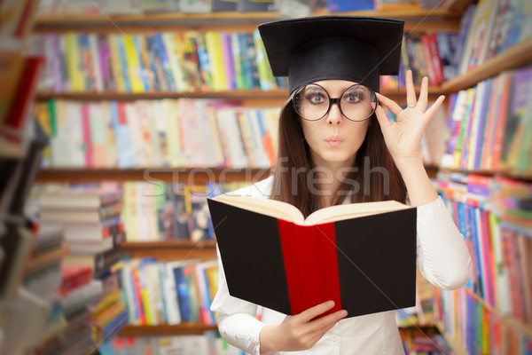Curious School Student Reading a Book in a Library Stock photo © NicoletaIonescu