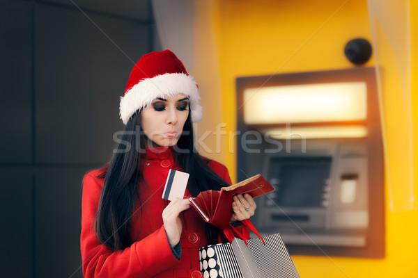 Noel kadın cüzdan banka ATM komik Stok fotoğraf © NicoletaIonescu