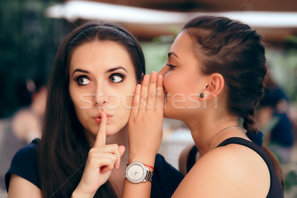 Indiscrete Gossiping Girl Telling Secrets to her Surprised Friend  Stock photo © NicoletaIonescu