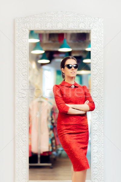 Woman in Red Suit in Fashion Store Stock photo © NicoletaIonescu