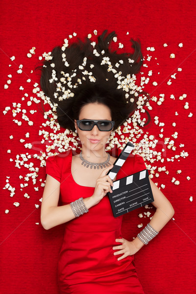 Cool Girl with 3D Cinema Glasses, Popcorn and Director Clapboard Stock photo © NicoletaIonescu