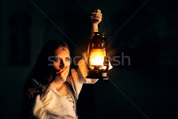 Scared Medieval Princess Holding Lantern  Stock photo © NicoletaIonescu