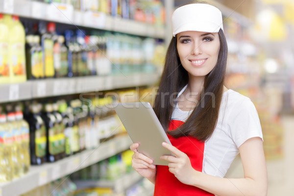 Smiling Supermarket Employee Holding a Pc Tablet Stock photo © NicoletaIonescu