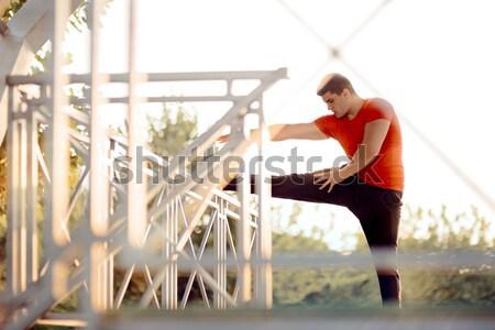 Athletic Man Doing Pull Up Bar Leg Raises Stock photo © NicoletaIonescu