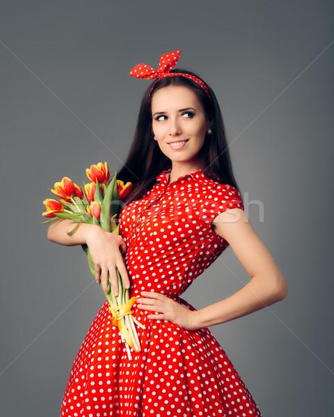 Cute Girl in Retro Red Polka Dress with Tulips Stock photo © NicoletaIonescu