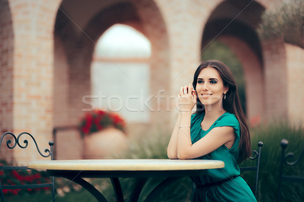 Smiling Woman Waiting for an Important Date at a Restaurant Table Stock photo © NicoletaIonescu