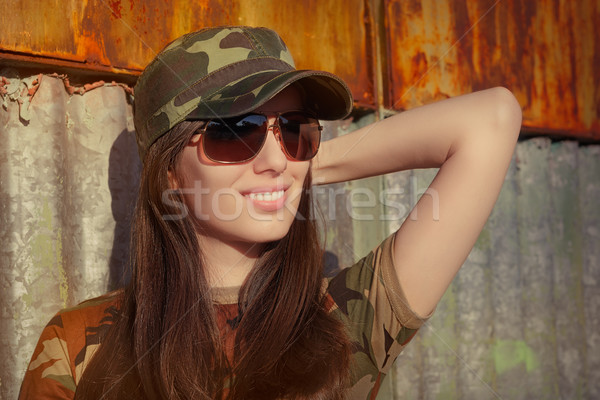 Smiling Young Woman Soldier in Camouflage Outfit Stock photo © NicoletaIonescu