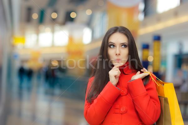 любопытный девушки красный пальто смешные Сток-фото © NicoletaIonescu