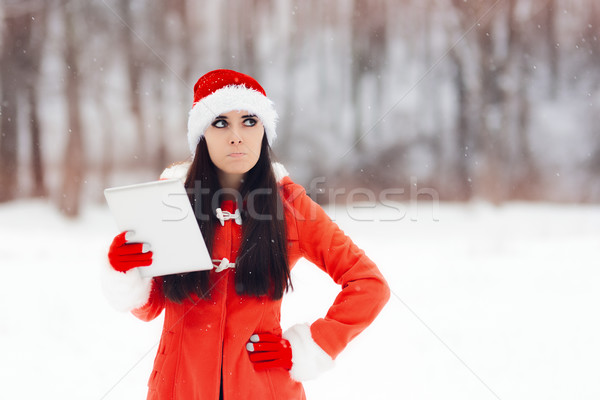 Unhappy Christmas Girl With Pc Tablet  Stock photo © NicoletaIonescu