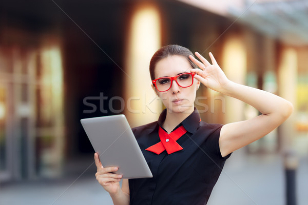 Discontent Businesswoman with Pc Tablet and Red Glasses Stock photo © NicoletaIonescu
