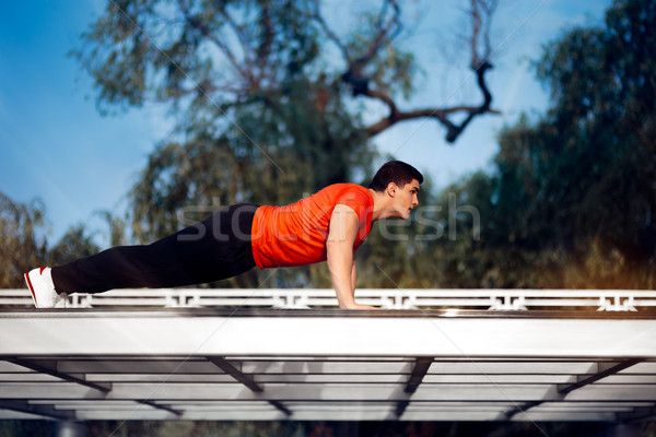 Athletic Man in Push-up Plank Position Training  Stock photo © NicoletaIonescu