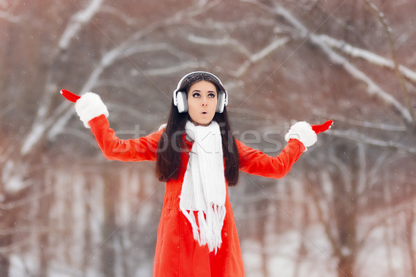 Surprised Winter Girl with Headphones Enjoying Snow Stock photo © NicoletaIonescu