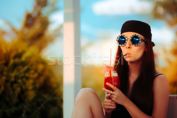 Cool Summer Girl with a Cocktail Glass and Oversized Fashion Sunglasses Stock photo © NicoletaIonescu