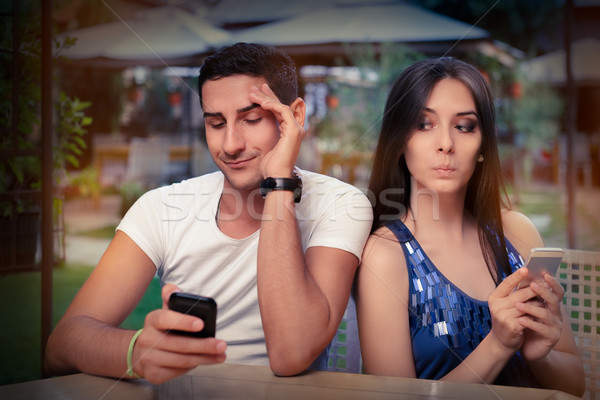 Secretive Couple with Smart Phones in Their Hands  Stock photo © NicoletaIonescu