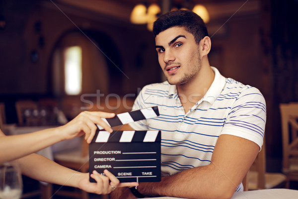 Professional Actor Raising his Eyebrow at the Camera  Stock photo © NicoletaIonescu