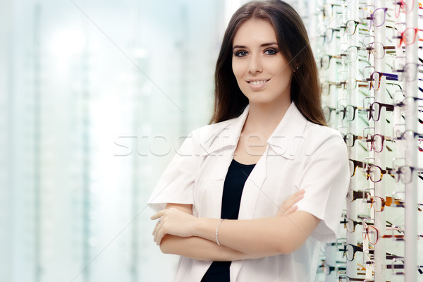 Happy Optician Standing in Optical Store Stock photo © NicoletaIonescu