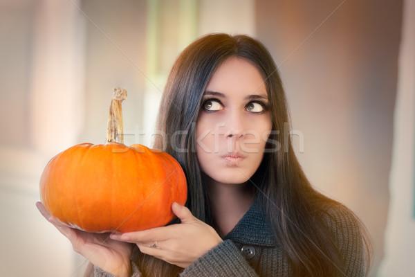Surpreendido mulher abóbora retrato fruto Foto stock © NicoletaIonescu