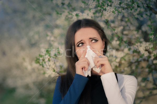 Girl with Spring Allergies in Floral Decor Stock photo © NicoletaIonescu
