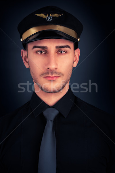 Man with Pilot Hat and Black Shirt Portrait  Stock photo © NicoletaIonescu