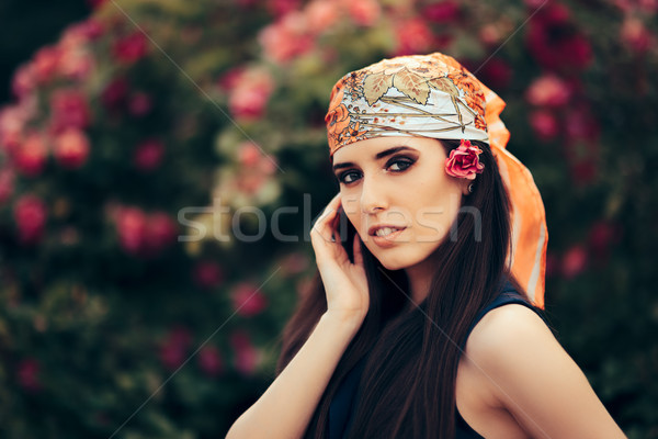 Fashion Woman Wearing Head Scarf in 70's Retro Style Outfit Stock photo © NicoletaIonescu