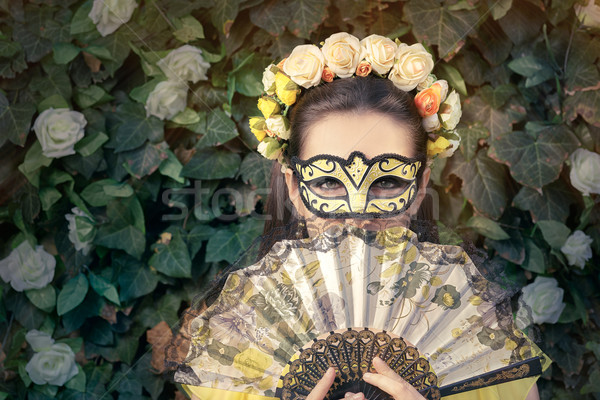 Beautiful Woman with Floral Wreath, Mask and Fan  Stock photo © NicoletaIonescu