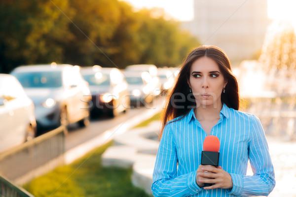 Surprised Female Reporter on Field in Traffic  Stock photo © NicoletaIonescu