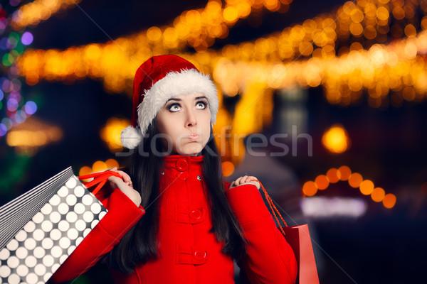Fáradt karácsony nő bevásárlótáskák vicces lány Stock fotó © NicoletaIonescu