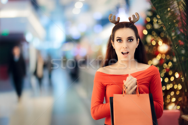 Funny Woman with Christmas Reindeer Horns Headband Shopping Stock photo © NicoletaIonescu