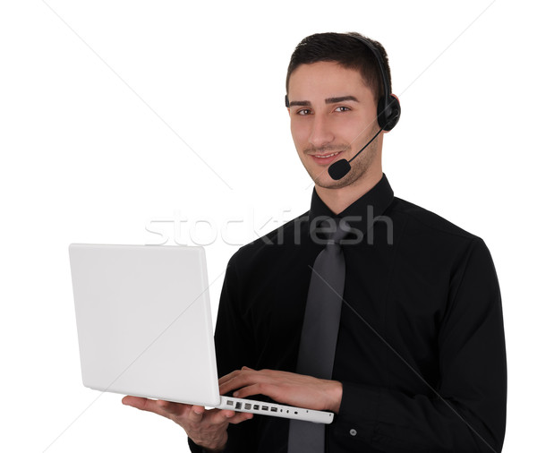 Young Man with Headset Holding Laptop  Stock photo © NicoletaIonescu