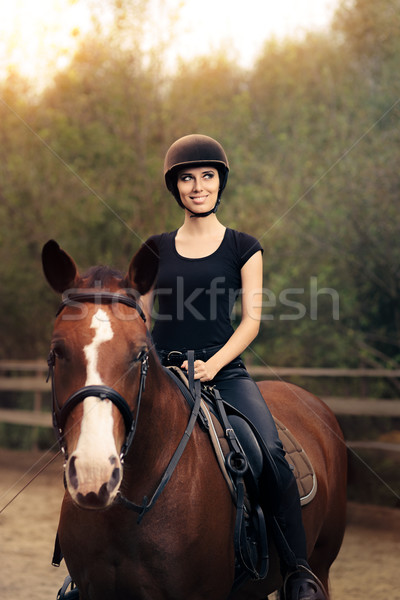Happy Horsewoman Ridding  in a Manege Stock photo © NicoletaIonescu