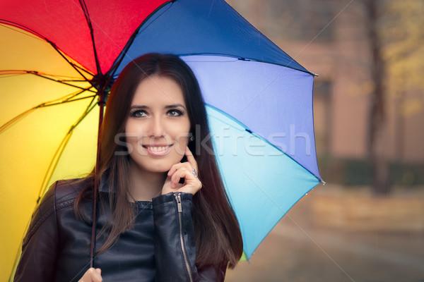 Boldog ősz nő tart szivárvány esernyő Stock fotó © NicoletaIonescu