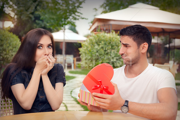 Happy Girl Receiving Heart Shaped Gift from her Boyfriend  Stock photo © NicoletaIonescu