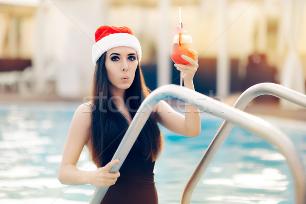 Surprised Christmas Woman with Cocktail at the Pool Stock photo © NicoletaIonescu