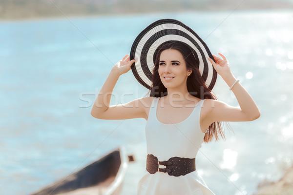 Nyár nő nagy csíkok tengerpart kalap Stock fotó © NicoletaIonescu