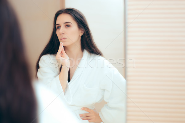 Woman in Bathrobe Cleaning Her Face with Make-up Remover Stock photo © NicoletaIonescu
