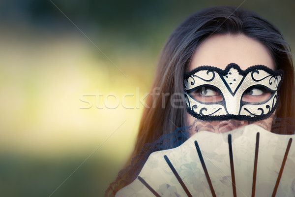 Young Woman with Mask and Fan Stock photo © NicoletaIonescu