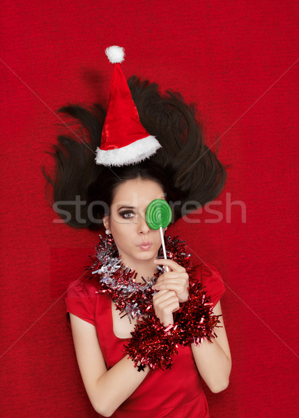 Stock photo: Funny Christmas Girl with Delicious Green Lollipop