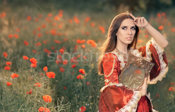 Beautiful Princess Holding Mirror in Summer Floral Landscape   Stock photo © NicoletaIonescu